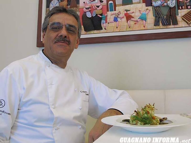 Lo chef salicese Mimino Simmini con un suo piatto